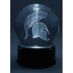 Michigan State logo etched in a musical, turning crystal